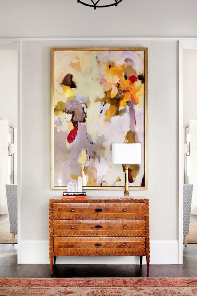 Swap out your current entryway art for a piece featuring soft pastel hues. Via Collins Interiors