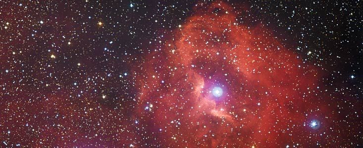 A Study in Scarlet | ESO 16 April 2014: This new image from ESO's La Silla Observatory in Chile reveals a cloud of hydrogen called Gum 41. In the middle of this little-known nebula, brilliant hot young stars are giving off energetic radiation that causes the surrounding hydrogen to glow with a characteristic red hue.