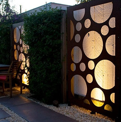 Graphic & bold garden fence. Metal panels in front of an existing fence add zip to a Brisbane, California garden. Designed by California firm Shades of Green Landscaping.