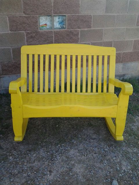 solid wood patio bench shown here in a yellow wood color with smooth clear coatvarnish finish