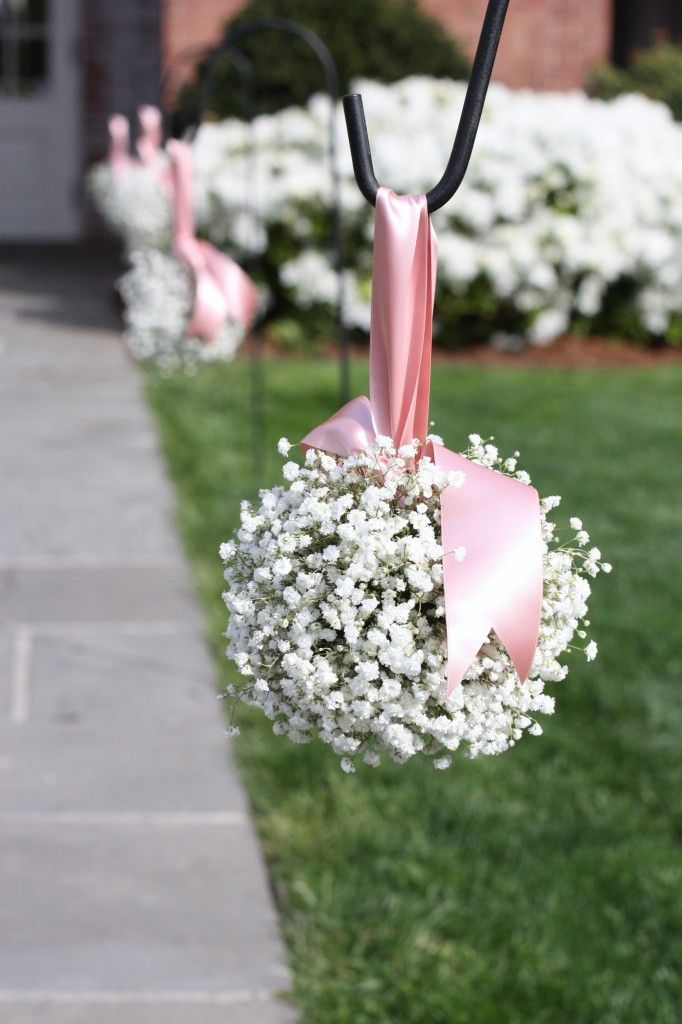 Baby's breath pomanders for outdoor wedding aisle.  On shepherd's hooks - which could be inserted into large planters and used for inside events too.