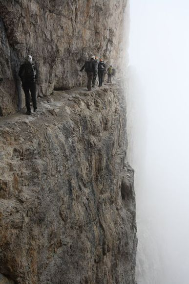 """Hiking, Brenta  A spectacular passage of the """"via ferrata"""" Bocchette Centrali, on the Dolomiti del Brenta, Italy. Along the lane there is a wire rope where the people can fasten on. #vertigo"""