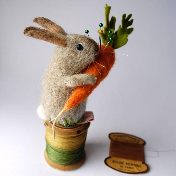 Original and one of a kind Needle Felted Pale Bunny with Large Carrot Pin Cushion Designed and hand made by Miss Bumbles. This Bunny Pin Cushion is made from 100% pure British and Norwegian wool with no armatures or wire. He is made of solid wool which has a high lanolin content, so