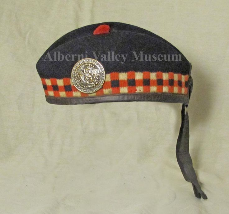 Black wool glengarry with red, white and black Scottish check band, that belonged to William H. Crowshaw (1888-1971).  Crowshaw served with the #102 Battalion in France during WWI.  However, this glengarry is associated with the #67 Infantry Battalion that was part of the Canadian Expeditionary Forces, 1914-19. The men of the 67th served in Canada between June 23, 1915 and April 5, 1916, and then in England between April 11, 1916 and May 5, 1916.  [Alberni Valley Museum Collection 1987.24.1]