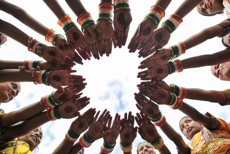 Indian girls wear tricolor bangles as they practice prior to taking part in Independence Day celebrations in Secunderabad, the twin city of Hyderabad, on August 15, 2017.