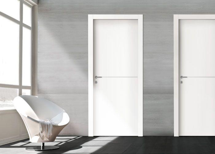 Porta tamburata della collezione DESIGN, con riga in alluminio.  Tantissime varianti disponibili porte Piacenza Lodi