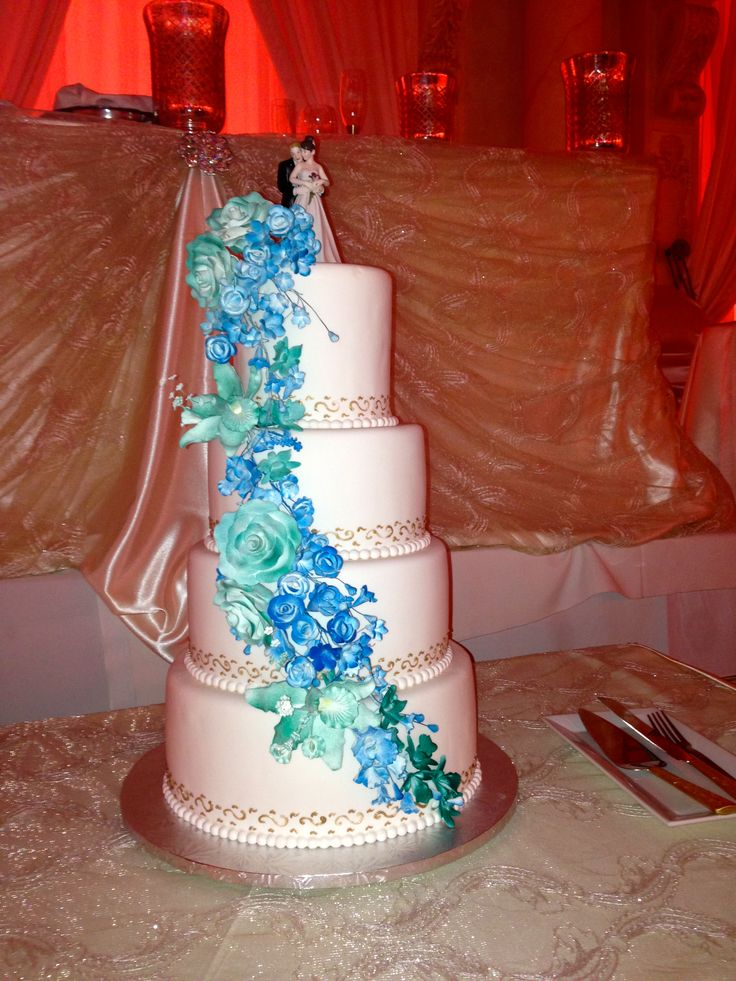 4tier white wedding cake with aqua and malibu blue orchids and roses gold freehand piping