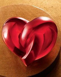 Two hearts intertwine to create this crystal paperweight from Lalique.