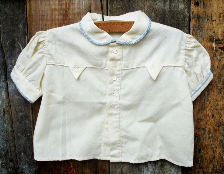 1940S CREAM BLOUSE  £12.00 1940's Cream blouse with patterned trim detail approx. age 6-12 months  1940's cotton blouse in superb condition. This button-down blouse has a a blue patterned trim and puff sleeves.