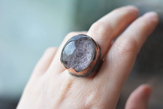 This is a copper and phantom quartz ring made in my studio. The phantom quartz is one of my favourite stones! You never know what you will see in it :) This one is shaped like a large bubble with grey-purple moss in the bottom. A bit like an underwater prairie. I have set it into a waivy setting. The ringband is hammered and textured. The copper has patina for enhancement. Reminds me of the crystal globe of a fortune teller! :) Ring size: 8 1/2 US on a ring mandrel, 9 mm wide ringband  M...