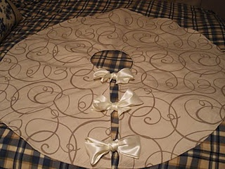 Buy the fabric & ribbon, send it to me and I'll make you a Christmas tree skirt...