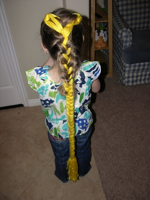 Rapunzel Hair extensions braided into hair. And bunches of other Rapunzel party ideas