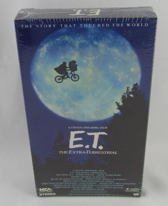 E.T. The Extra-Terrestrial VHS Tape. A Steven Spielberg Film. MCA Home Video, Inc. (1988).  After a gentle alien becomes stranded on Earth, the being is discovered and befriended by a young boy named Elliott (Henry Thomas). Bringing the extraterrestrial into his suburban California house, Elliott introduces E.T., as the alien is dubbed, to his brother and his little sister, Gertie (Drew Barrymore), and the children decide to keep its existence a secret. Soon, however, E.T. falls ill…