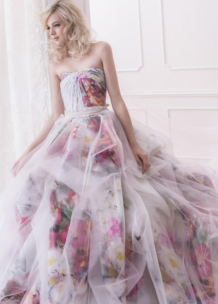 [The sheer overskirt gives it a dreamy, ethereal look.  I don't think you would get the same effect if using it over a solid color.]   Vida.