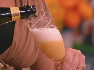 Peach Bellini.  This recipe from Rachel Ray calls for Prosecco or sparkling white wine... I also use Champagne....  :)