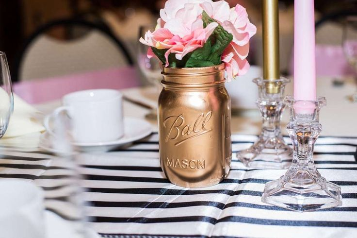 Gold mason jar with flowers at a Paris bridal shower party! See more party planning ideas at CatchMyParty.com!