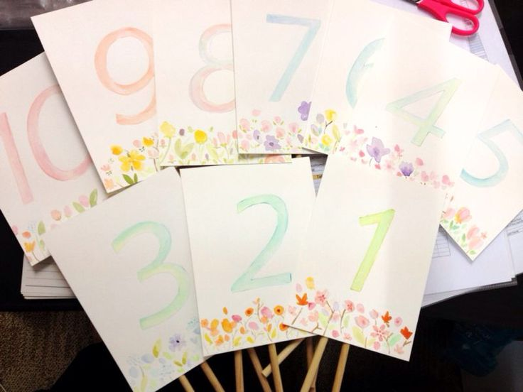 Table numbers hand painted by the groom