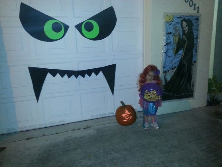 our diy boogie monster halloween decoration on our garage door
