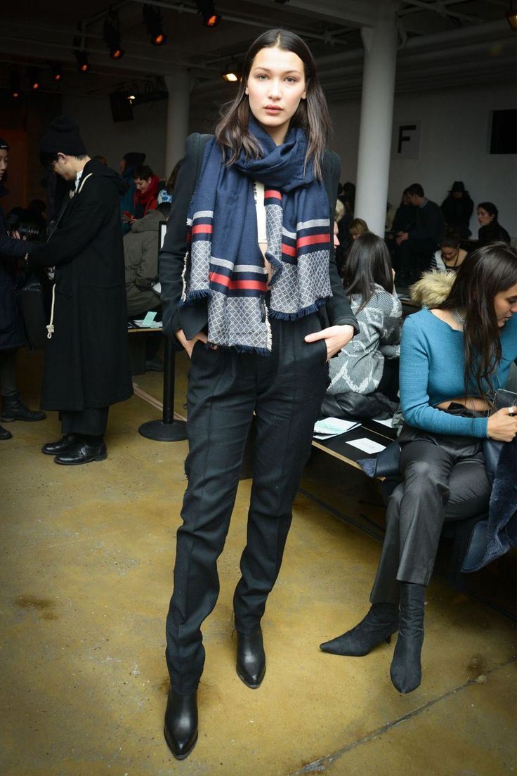 At the Baja East show, Bella wore a printed scarf with tailored trousers.