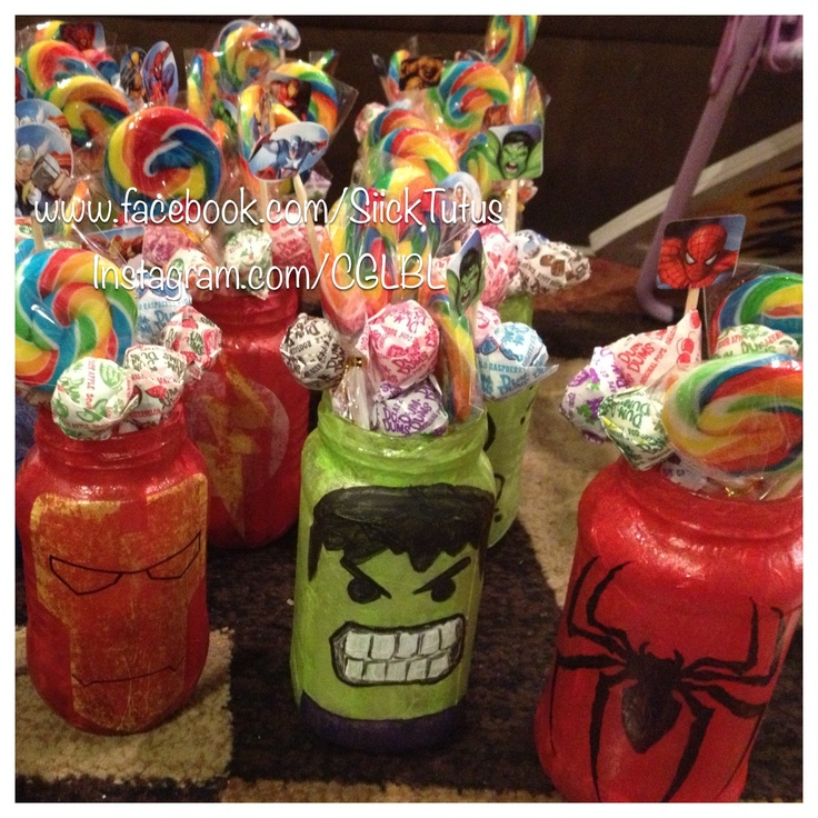 Created center pieces from mason jars. Modge podged tissue paper, and either painted, drew, or pasted on superhero symbols or faces. Added some lollipops for sweets and some small super hero stickers at the ends of skewers sticks. ENDLESS possibilities.