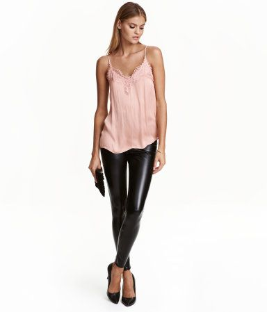 Black. Leggings in imitation leather with concealed elastication at waist.