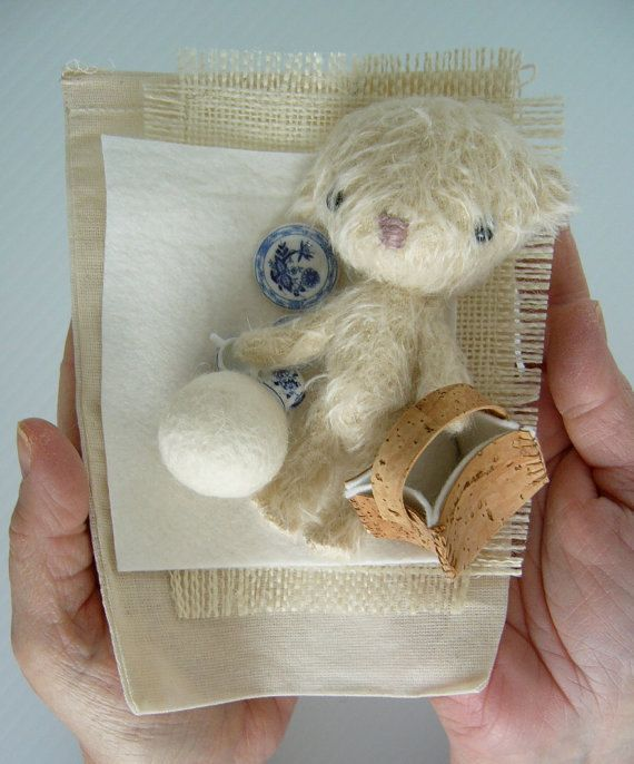 Nice miniature teddy bear mohair wool. Search a friend for fun. This little teddy likes best days outdoors. It is greedy and always carries with him his pretty picnic basket. He loves to run and play ball. He enjoys to nap under a tree with his pretty and small blanket.  Handmade this lovely bear is made of mohair. Bourre natural kapok fiber, non-allergic and anti-mold. It is hinged without metal