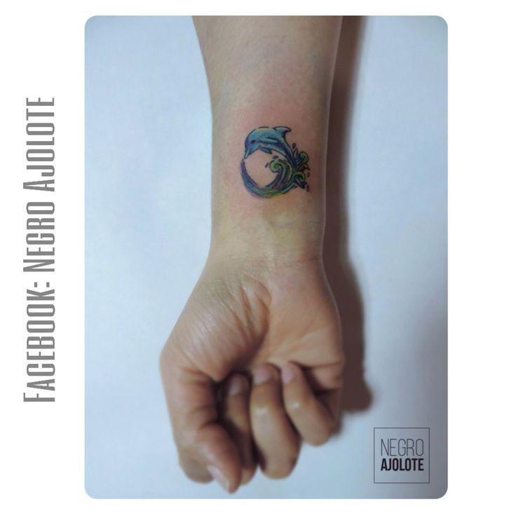 Tattoo dolphin arm