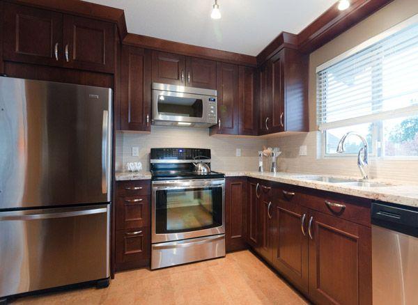 alder wood :: victorian door style :: hazelnut stain #kitchen #cabinets