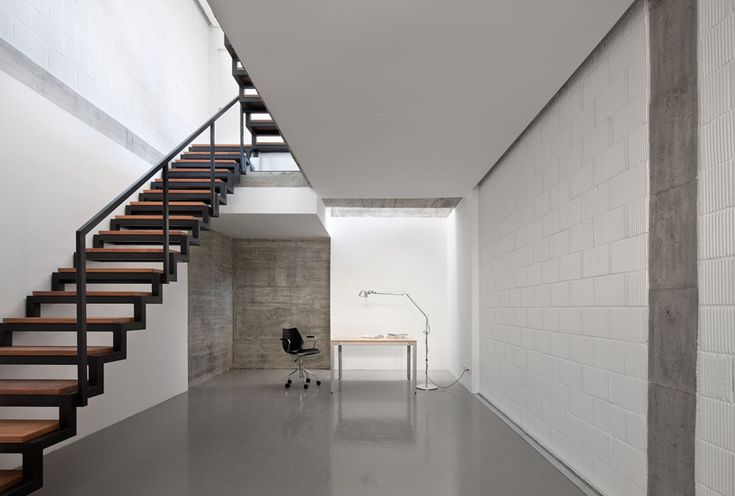 Polished concrete floors and white walls reflect light at More House, Cantabria, Spain by Acha Zaballa Arquitectos