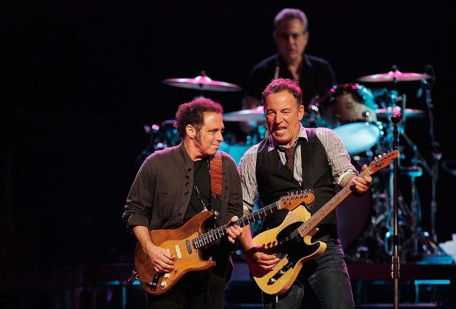"""Nils Lofgren (left) plays guitar alongside Bruce Springsteen. The E Street Band plays the BMO Harris Bradley Center at 7:30 p.m. Thursday. The band is playing Springsteen's 1980 double album """"The River"""" in its entirety."""