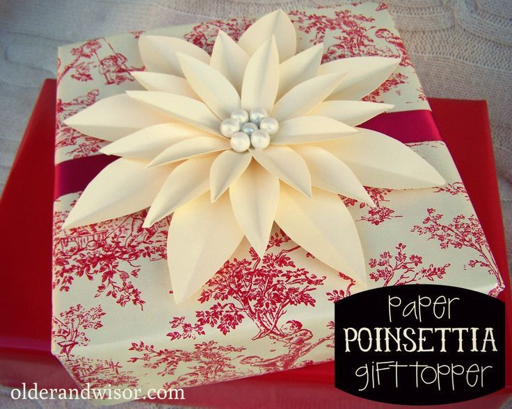 Easy Paper Poinsettia Gift Topper - gorgeous, but you could change the colors and make it look like another flower for different holidays or occassions.