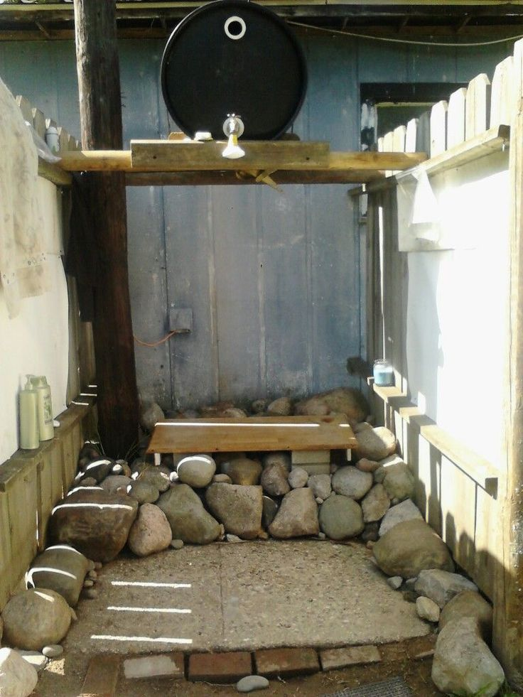 This Solar Shower a family built in michigan gets used all summer long, and i can see why.  Surrounded by rocks and heated by the sun, its beautiful, simple, easy to make and fun to use!   To follow our story on Building our own Off Grid Tiny House, and see other great updates, follow us at www.livingbiginatinyhouse.com