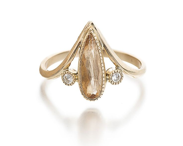 Imperial Topaz Eiffel Ring. What a neat stone!