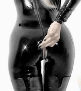 Slut in rubber zips herself in rubber sack