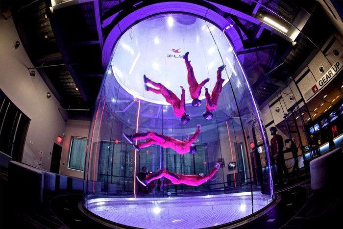 "With new locations in Chicago suburbs Rosemont and Naperville, iFly Indoor Skydiving offers a unique group activity: participants ""fly"" or float on a column of air that's generated by winds blowing at 75 to 175 miles per hour. Before the activity, all guests take a brief course that covers body positioning and hand signals for flying; they then suit up with helmets, flight suits, ear plugs, and goggles."