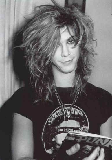 Duff McKagan.//the reason I loved Guns and Roses