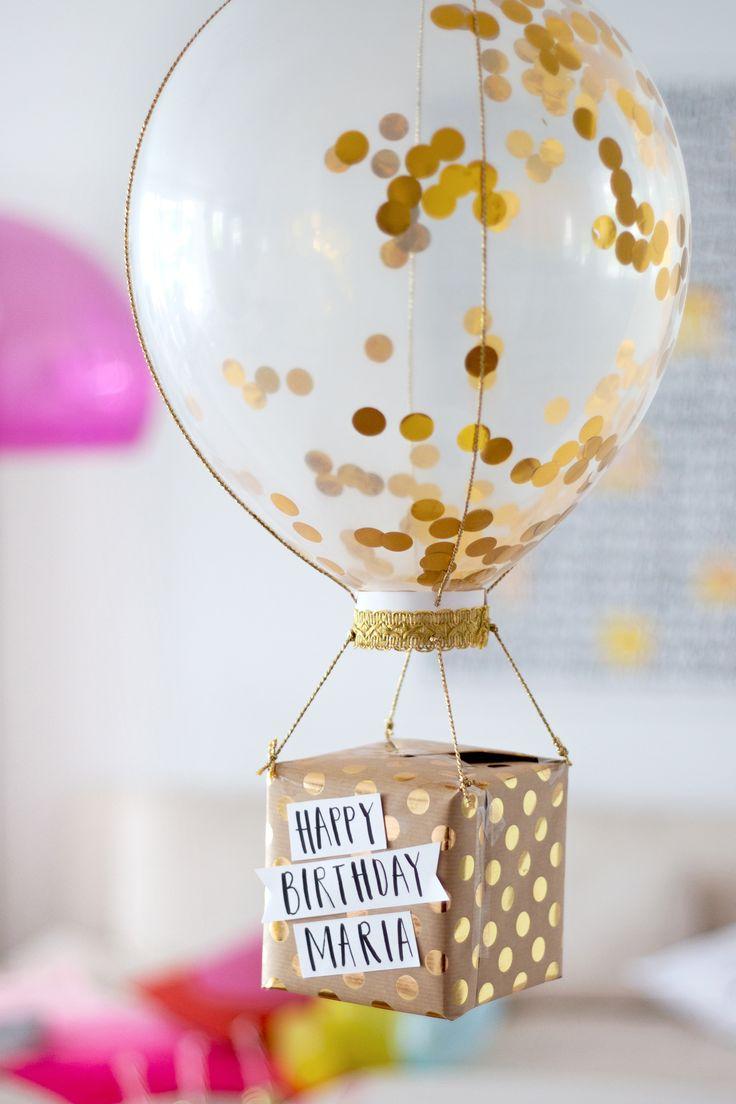 DIY Geschenkverpackung: Glitzerballon mit Geschenk
