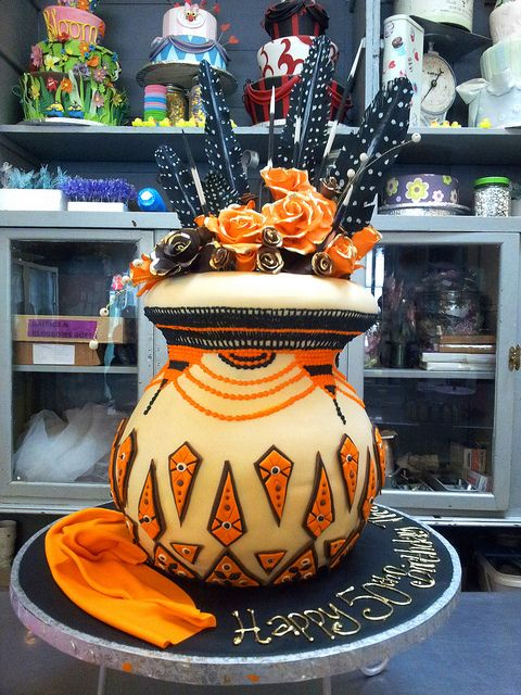 3D Traditional African Pot  shaped Wicked Chocolate cake covered in cream fondant with orange, brown & gold decorations by Charly's Bakery-south africa