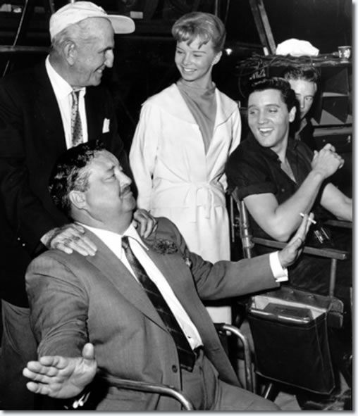 Jackie Gleason (seated, left), Laurel Goodwin and Elvis Presley (seated, right) on the set of Girls!, Girls!, Girls!