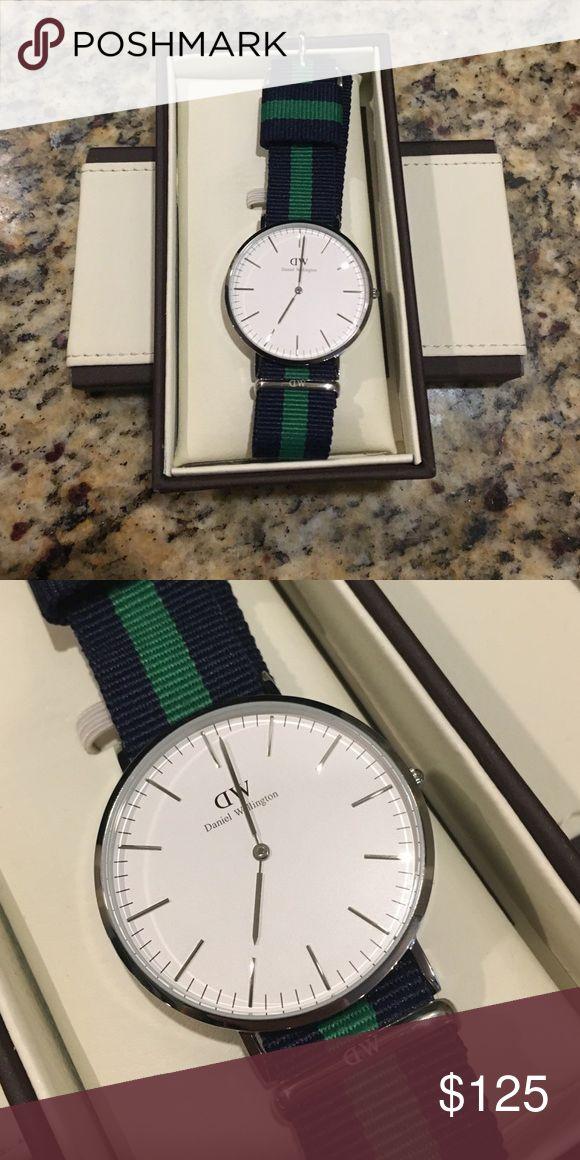 Genuine Daniel Wellington 40mm Watch Nato Strap A silver-tone Daniel Wellington watch with a 2-tone NATO strap. White dial. Single crown design. Daniel Wellington Accessories Watches