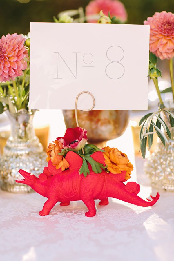dinosaur table number - photo by Julie Wilhite Photography http://ruffledblog.com/eclectic-outdoor-texas-wedding