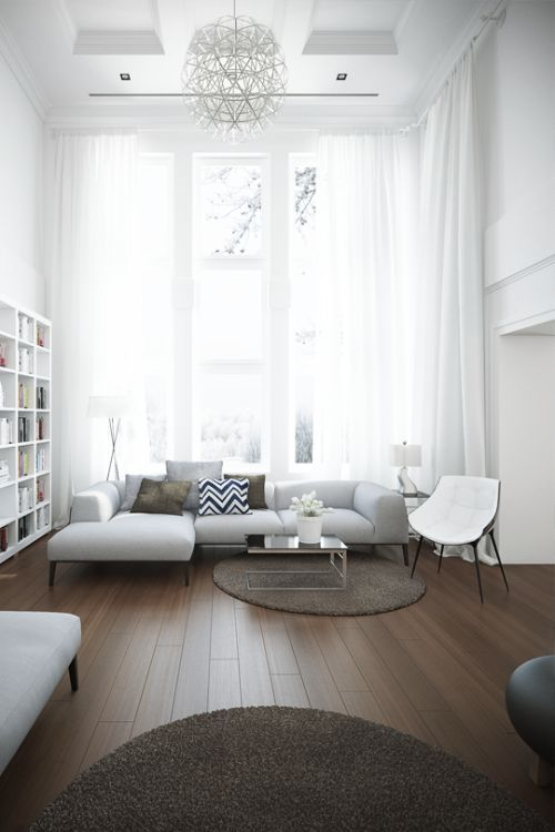 Loving the elegance and design of this living room with the minimalist white design. Those floor to ceiling windows allow loads of light in!
