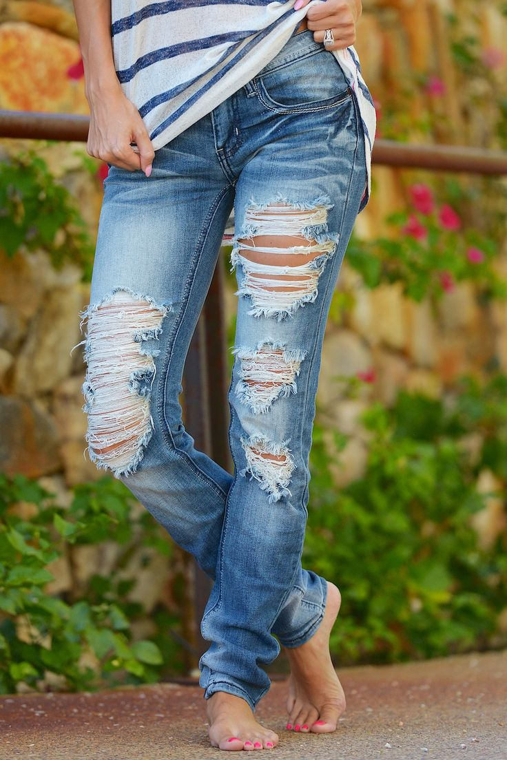 "Our best selling denim in a fun new wash that goes with everything, white accent stitching! Button fly with zipper, 5 pockets. Inseam Approx 32"" Long. 97% Cott"