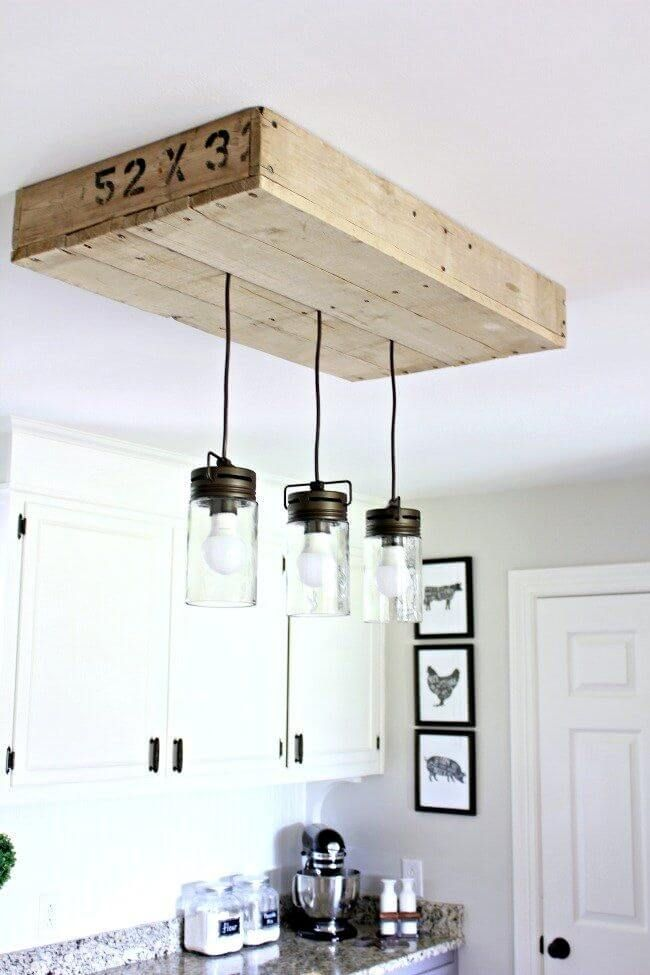 Barn Style Lighting Hanging From A Pallet Floating Shelf