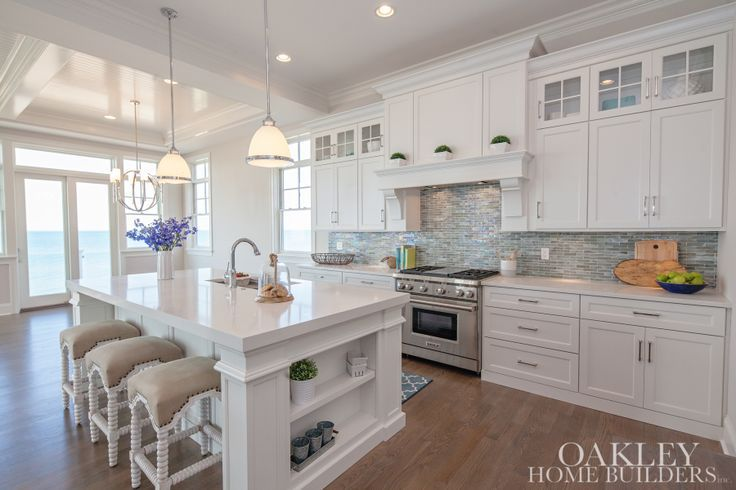 Beautiful White Kitchen, Home Builder's site with quite a few gallery pics. Lots of home inspiration