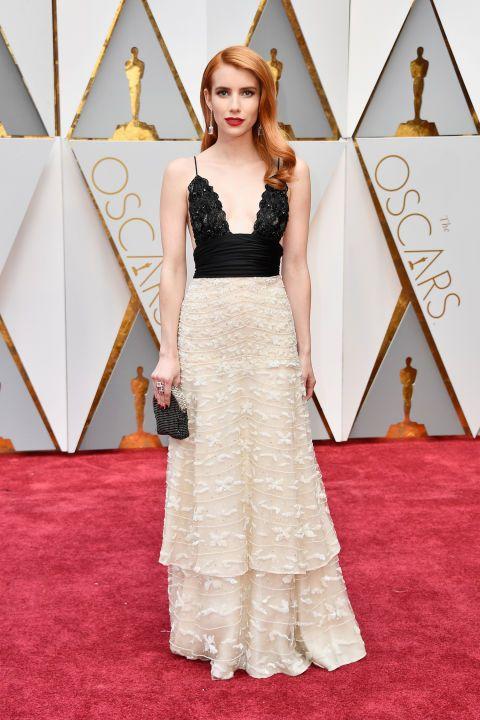 Emma Robers Armani Privà deep v-cut dress couldn't be any more breath-taking!