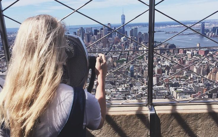 The metropolis of NYC shines in the summer sun from the top of the Empire State Building.  Photo by McKell J. (mckell_johnson on Instagram)