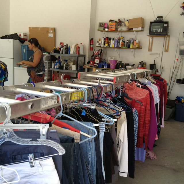 Garage Sale Tip: use an extension ladder to hang clothes for sale. Genius!