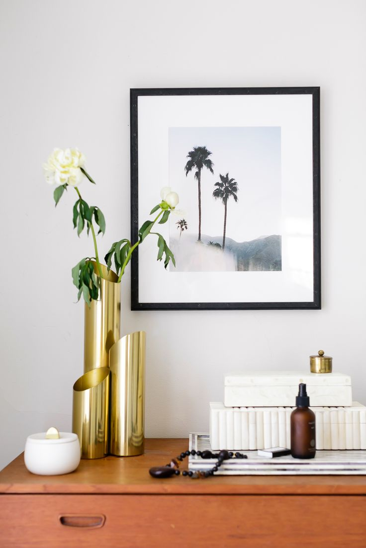 brass vase and minimalist bedroom decor styling via @citysage