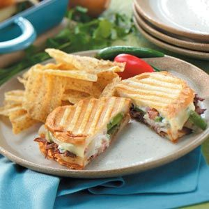 Southwestern Beef Panini Recipe -This fast favorite will hit the spot, particularly when you're short on time. Shredded beef, spicy Jack cheese and sauteed onion and green pepper are sandwiched between slices of hearty bread, then lightly grilled in a panini pan.